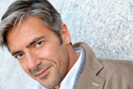 Portrait of handsome mature man in town 版權商用圖片