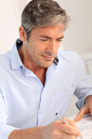 mature adults: Portrait of handsome office worker Stock Photo