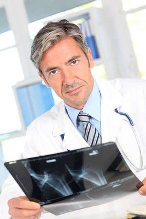 Man looking at Xray results Stock Photo - 10979002