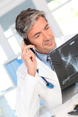 medicalcare: Doctor calling patient to give medical results