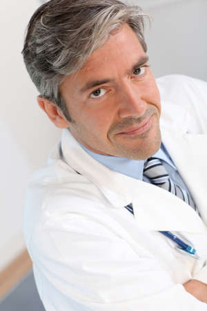 medicalcare: Portrait of handsome doctor Stock Photo