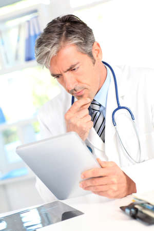 medicalcare: Portrait of medical people using electronic tablet Stock Photo