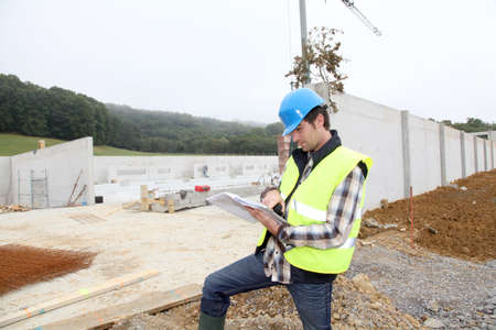 Construction manager using electronic tablet on site photo