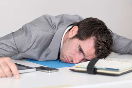too much: Businessman having too much work Stock Photo
