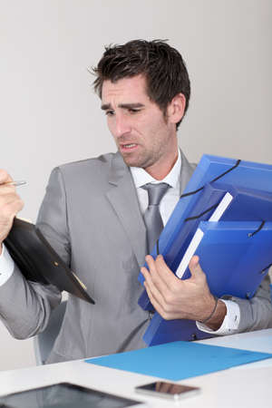 officeworker: Businessman overwhelmed with work