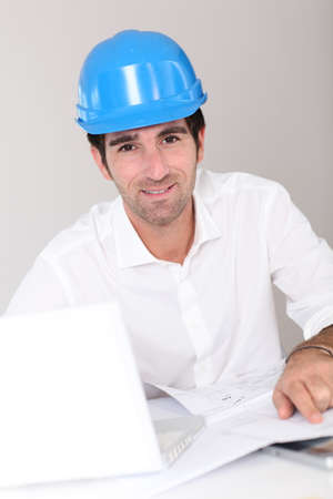 promoter: Site manager in office with security helmet