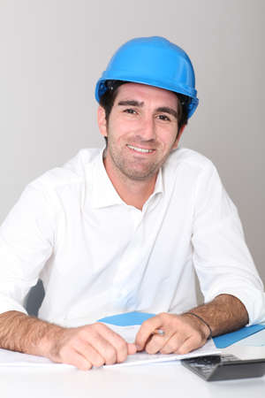 security helmet: Site manager in office with security helmet