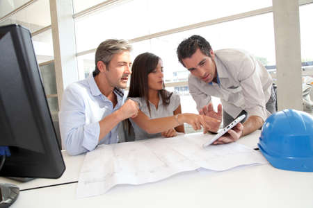Team of architects working in office Stock Photo - 10978960