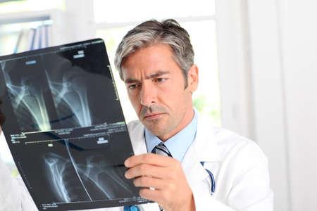Man looking at Xray results photo