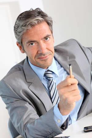advantages: Businessman giving product advantages to client Stock Photo