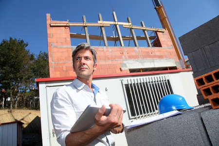 pda: Entrepreneur on building site with tablet