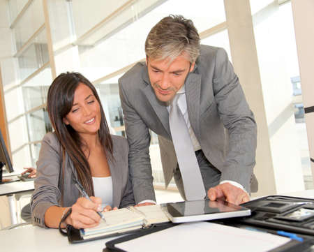 Manager and businesswoman meeting in office photo