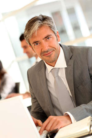 40 years old man: Mature businessman working on laptop computer Stock Photo