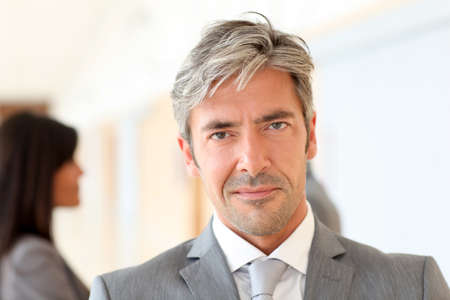 40 years old man: Portrait of handsome businessman standing in hall Stock Photo