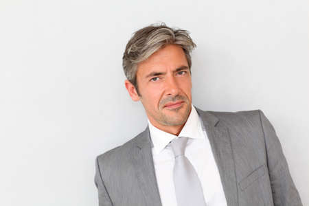 40 years old man: Portrait of handsome businessman standing on grey background Stock Photo