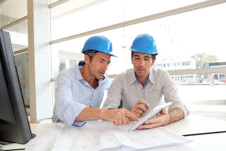group plan: Architects working on construction plan
