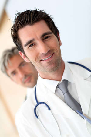 Portrait of doctor standing amongst medical team Stock Photo - 10979223