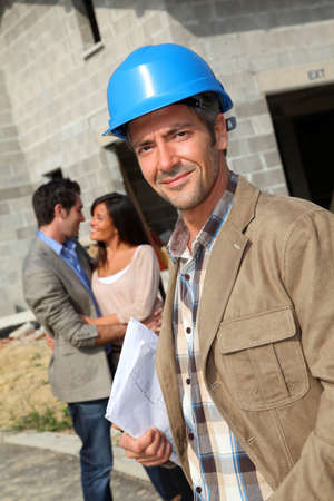 Portrait of smiling entrepreneur standing on construction site photo
