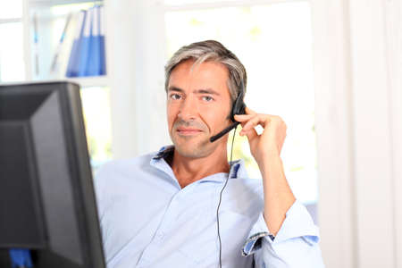 Customer service employee with headphones photo