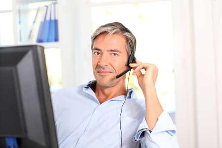 callcenter: Customer service employee with headphones Stock Photo