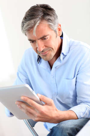 Office worker using electronic tablet photo
