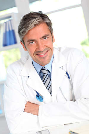 40 years old man: Portrait of handsome smiling doctor
