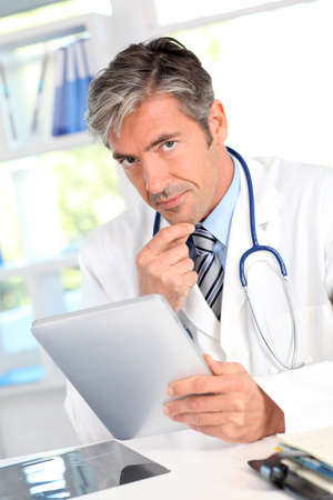 40 years old man: Portrait of medical people using electronic tablet Stock Photo