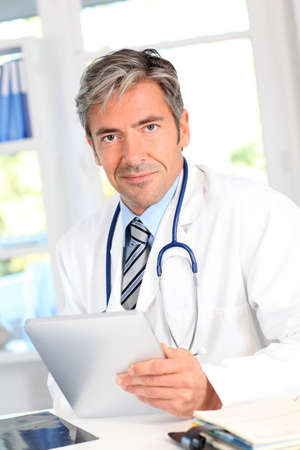Portrait of medical people using electronic tablet photo