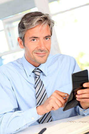 Manager in office calculating budget photo
