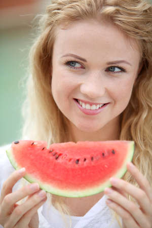 Portrait of beautiful woman eating fresh fruits Stock Photo - 11283937
