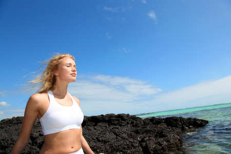 Woman breathing by the sea Stock Photo - 11283884