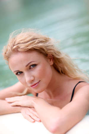 Beautiful blond woman in swimming pool Stock Photo - 11283407