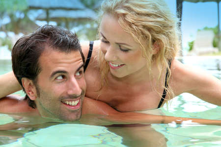 Couple in luxury hotel swimming-pool photo