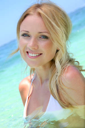 Beautiful blond woman in ocean water photo