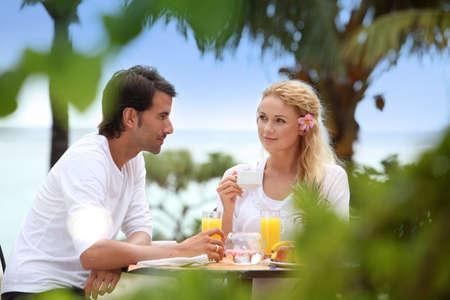 resorts: Couple having breakfast in luxury resort