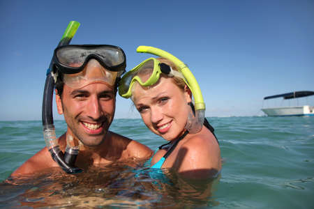woman diving: Couple with snorkeling equipment Stock Photo