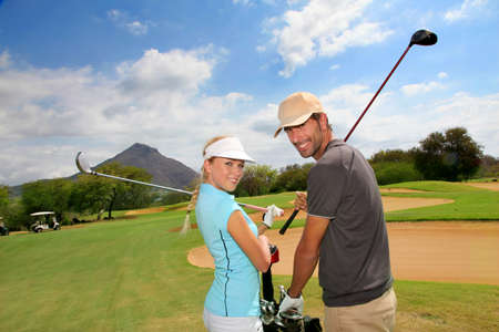 woman golf: Golfers on golf course