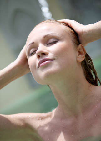 wet hair: Beautiful woman in spa pool with jets Stock Photo