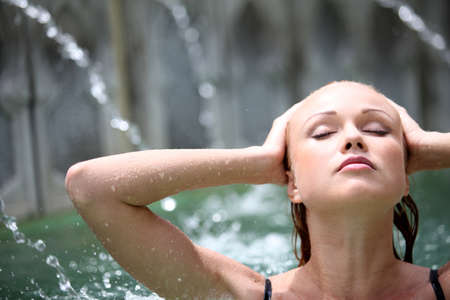 thalasso: Beautiful woman in spa pool with jets Stock Photo