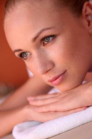 beautycare: Portrait of woman laying on massage bed
