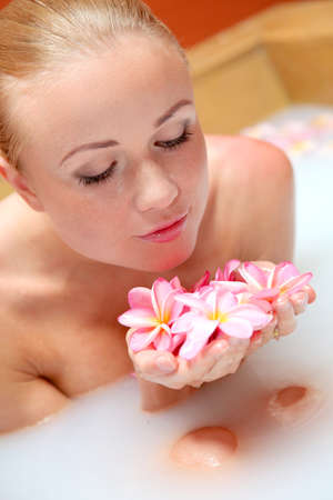 Portrait of beautiful woman in milk bath photo