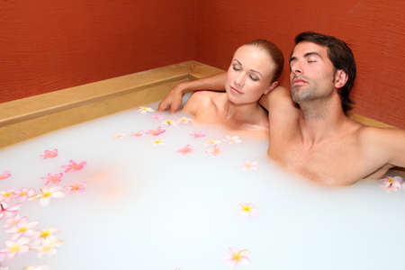 Couple relaxing in spa milk bath Stock Photo - 11283668