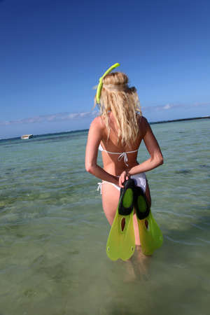 Smiling woman wearing snorkeling outfit photo