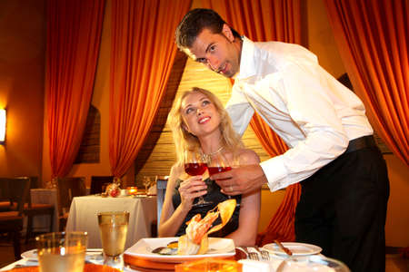 Couple dining in a fancy restaurant photo