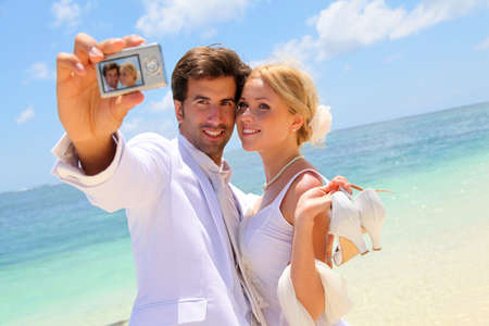 taking a wife: Just married couple taking picture of themselves