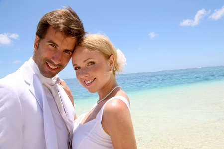 destination wedding: Portrait of just married couple on the beach