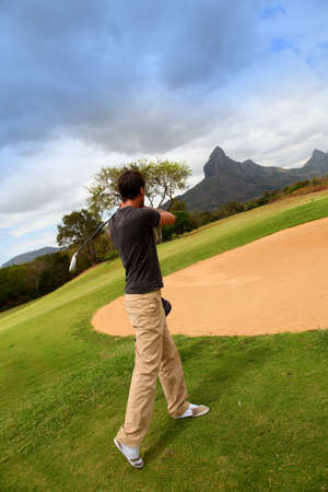 Man playing golf  photo
