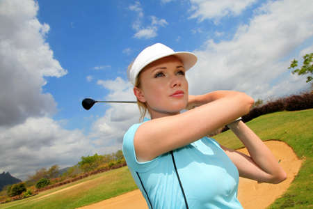 putter: Portrait of woman playing golf