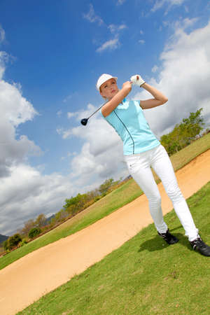 Portrait of woman playing golf photo