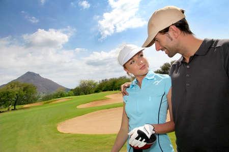golfing: Golfers on golf course